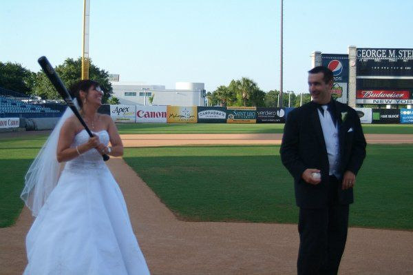The couple having fun on-field after the ceremony