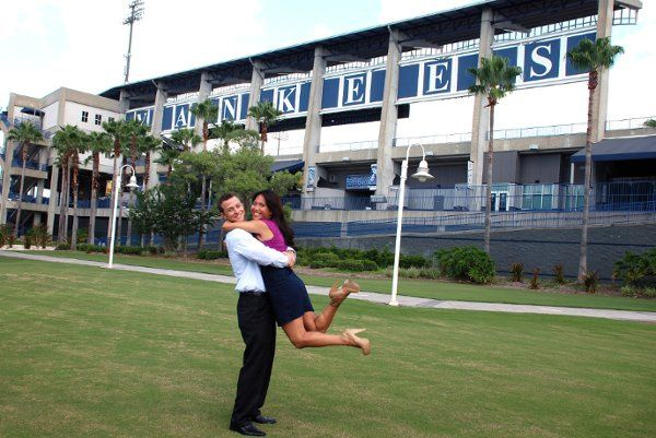 Marisa and Jeff having fun with their photo shoot on stadium grounds
