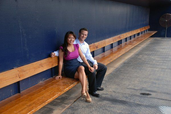 Marisa and Jeff in the Yankees' dugout during their engagement photo shoot