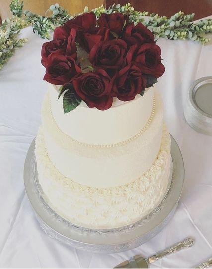 Rose topped three tier cake