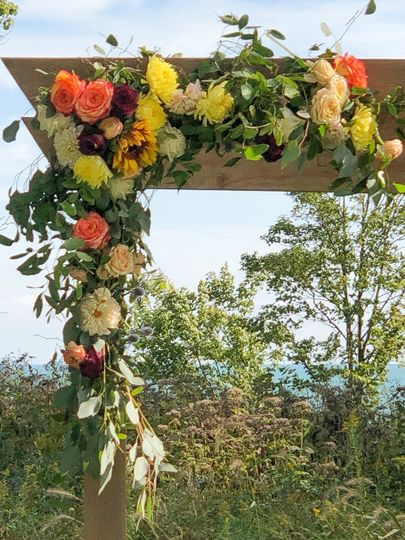 Outdoor wedding in blooms and