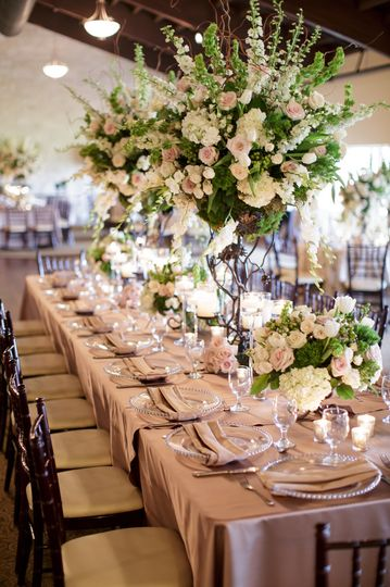 Indoor long table setup with flower decors