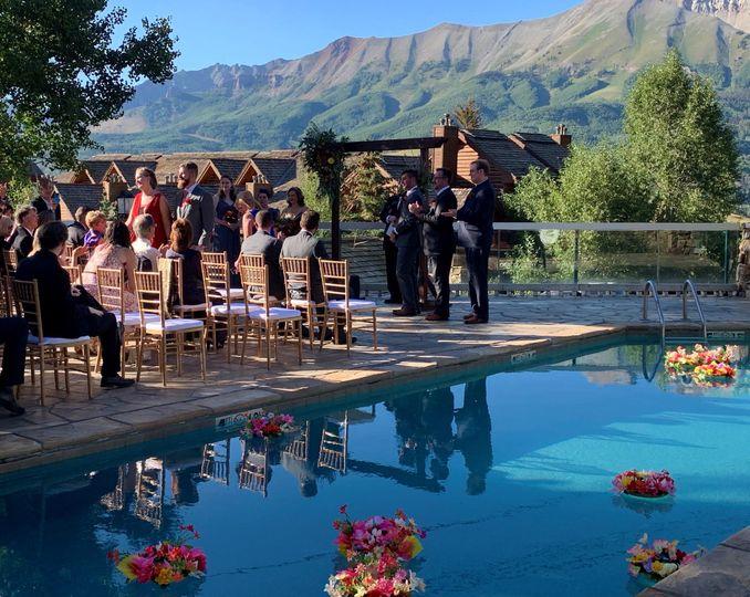 Poolside terrace wedding ceremony