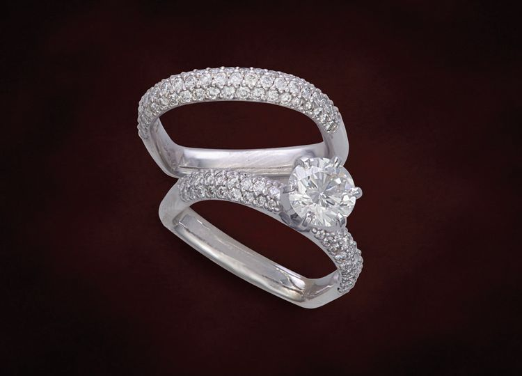 Domed pave set round brilliant cut diamonds in this matching wedding set with designer ring bottom....