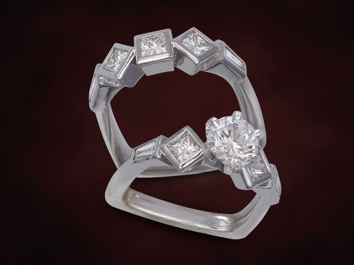 Modern Bezel Bridal set with square modified brilliant cut and tapered baguette accents and round...