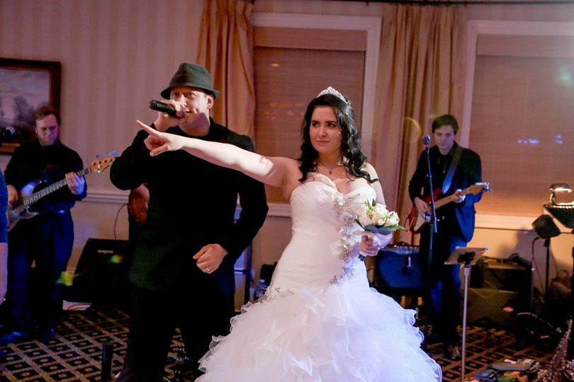 The bride with the vocalist of the band