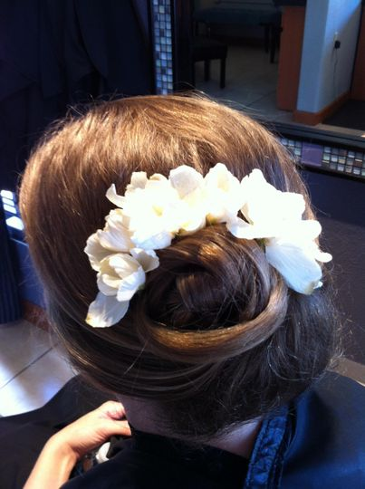 Updo with fresh flower accents