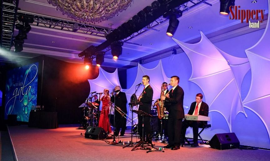 Slippery Band onstage in Kapalua, Maui appearing at an international corporate event.