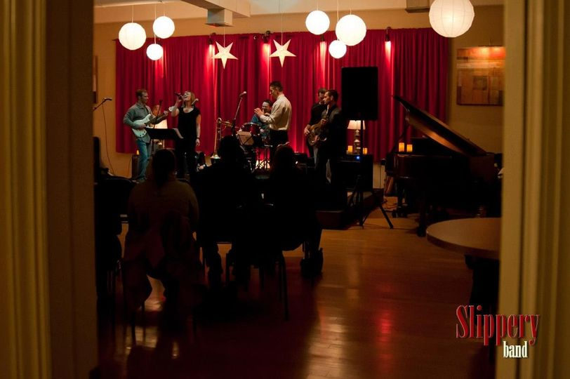 Slippery Band onstage during one of our monthly live performance showcases.