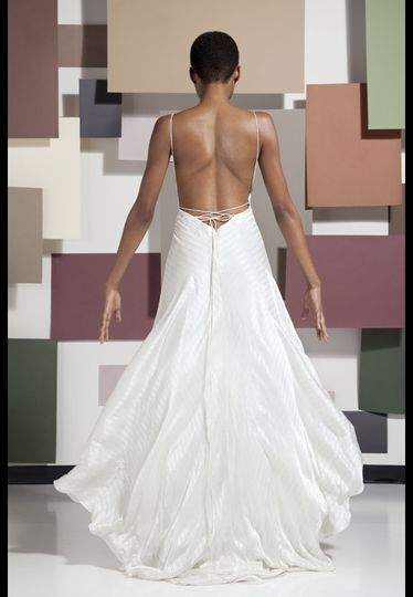 This bridal siren is irresistibly daring and edgy in this shadow striped, ivory, silk charmeuse...