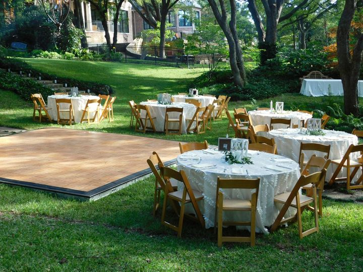 Backyard wedding ceremony and reception. Shady, grassy at-home comfort. Natural wood dancefloor and...