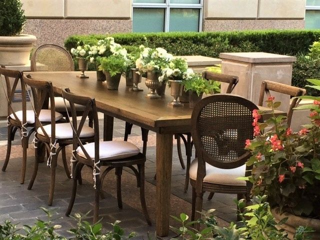 Natural Wood Farm Table, Cane Back Louis Chairs, X Back Pilgrim Chairs on the patio.