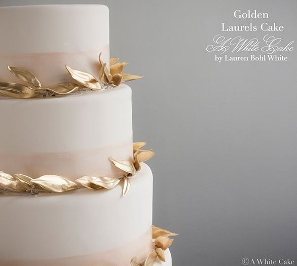 White cake with gold leaves