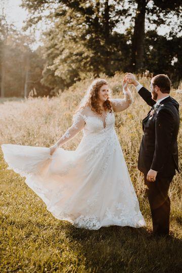 Couple dancing in a field