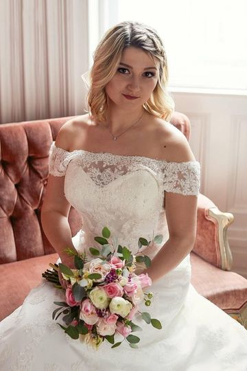 Bride in off-shoulder wedding dress