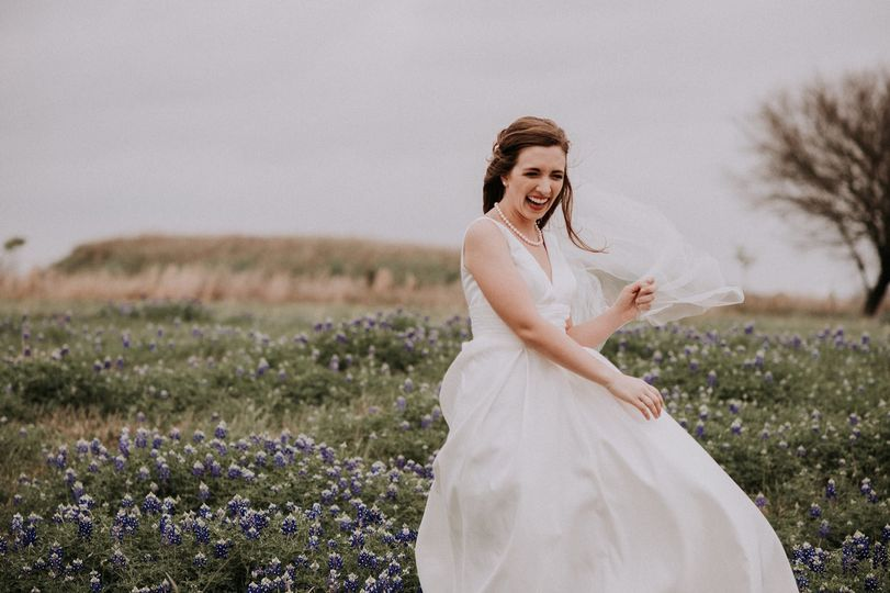 A twirl in the dress before a field of flowers