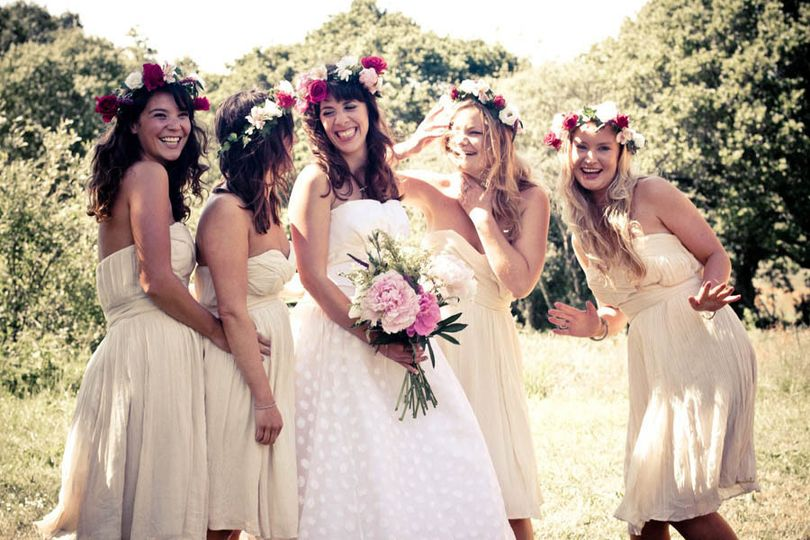 Outdoor ceremonies are incredibly popular. This bridal party is celebrating the abundance of all the...