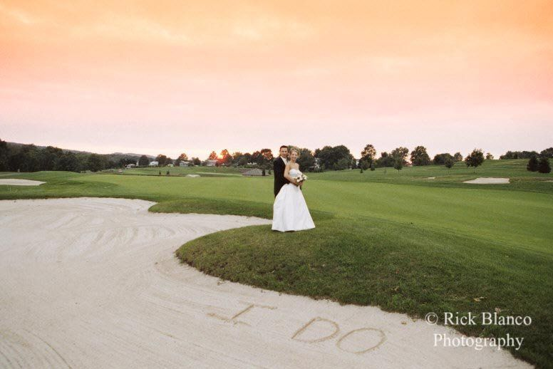 A bride and groom enjoy the sunset and landscape