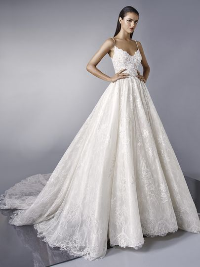 Enzoani	Maddie		Make a dramatic entrance with this dreamy ball gown featuring romantic overlace. The...