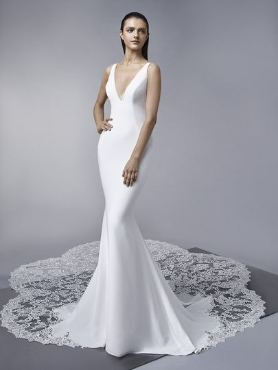 "Enzoani	Marley		""Sleek and elegant, this full-length mermaid gown features a simple front and a..."