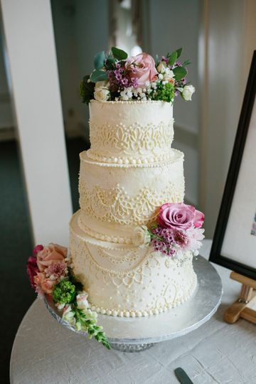 Wedding cake with lace detail and flowers