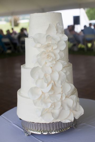 White wedding cake with white floral design