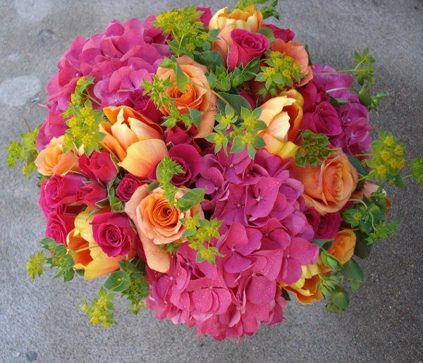 Bright pink, hot orange and lime green give this classic bride's bouquet a modern look