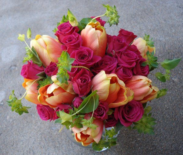 hot pink and bright orange compliment each other well in this vibrant bouquet