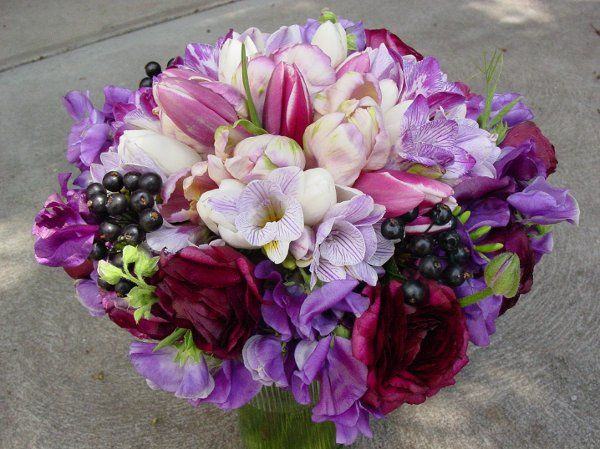 deep colors contrast with pastels in this seasonal spring bouquet