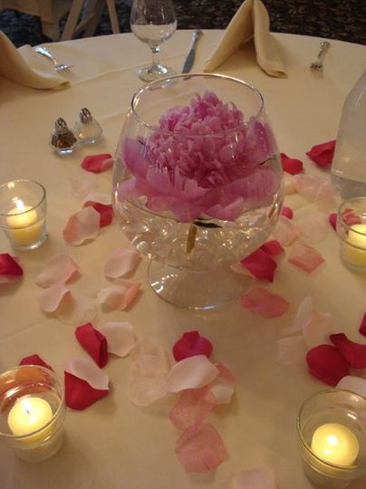 A single floating peony makes a beautiful yet affordable table centerpiece