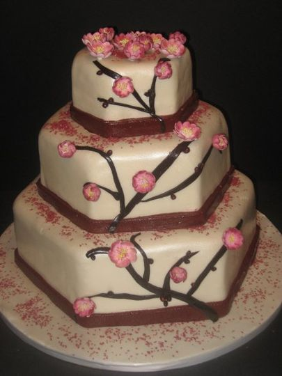 This cake was so much fun to make! It's covered in fondant with handmade cherry blossoms and berries...