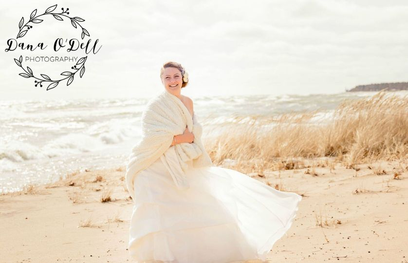 Happy bride at winter beach wedding