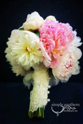 Pink and white bouquet with wrap from bride's mother's wedding dress.