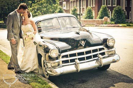 Bride and Groom with their vintage car.
