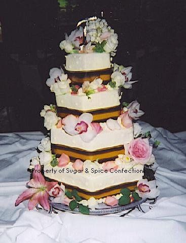 Butter Cream Wedding cake with fresh floral and matching ribbon (The National Golf Club-Parkville,...