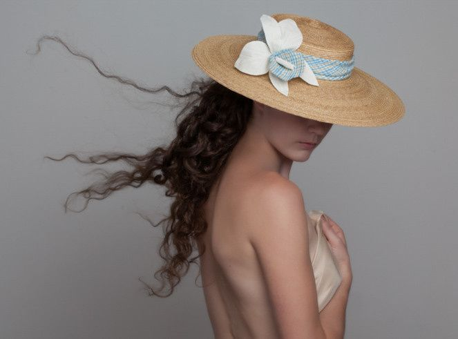 Feminine straw hat adds a romantic touch to your ensemble.