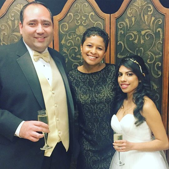 Groom, officiant and bride