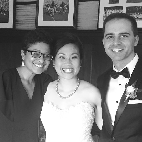 Wedding officiant with the bride and groom