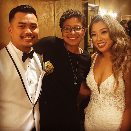 Groom and bride with their officiant