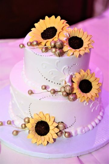Simple wedding cake with sunflowers