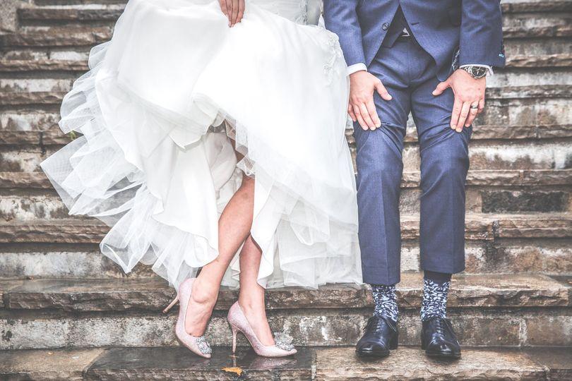 Newlyweds walking down  stairs