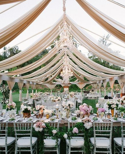 Beautiful tent frame with stunning sheers to captivate the mood