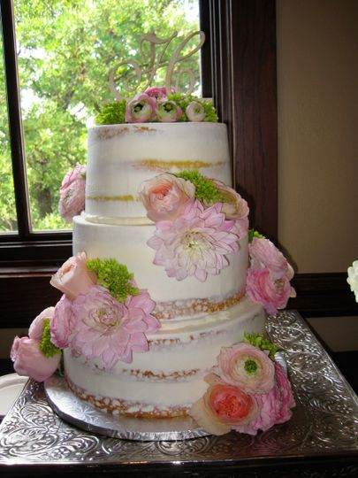 Naked cake with pink flowers