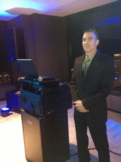 Grand DJ Entertainment entertainer Rick Pascoe at the Willis Tower SkyDeck. Rick's energy and...
