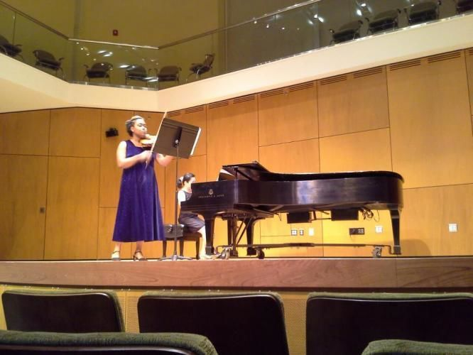 Violinist and pianist on stage