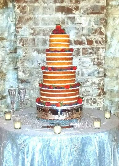 Naked Cake garnished with fresh berries. Contains 134 servings.