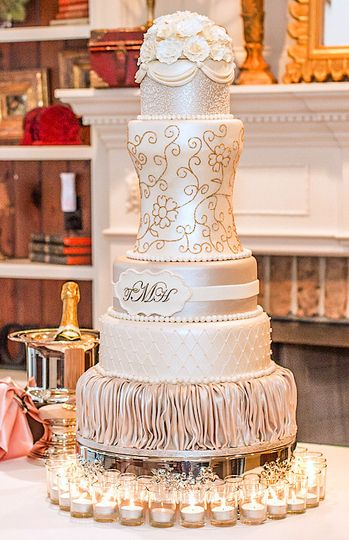 Elegant wedding cake, with edible gold flake floral pattern. Contains 216 servings. Everything is...
