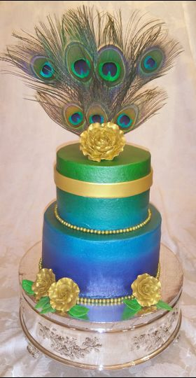 Peacock Theme cake, everything is edible forms of cake and fondant except the feathers. Contains 40...