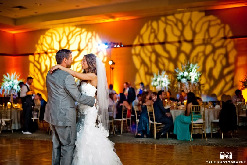 Wedding couple with pinspots, gobos, and uplighting.