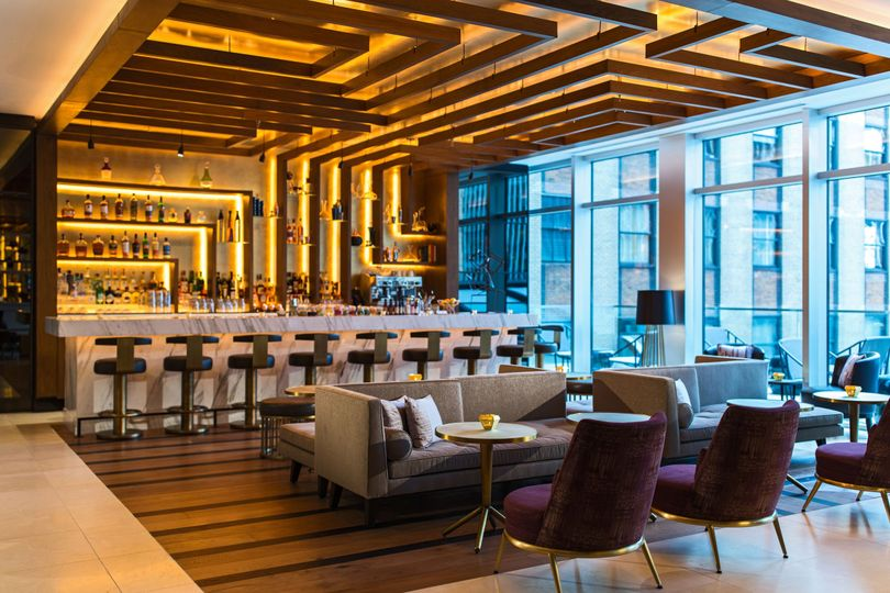 Grab a handcrafted cocktail at Thread Bar, located in our lobby.